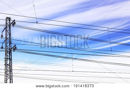 Black wire on blue sky background at day