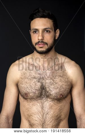 portrait of handsome shirtless muscular hairy man