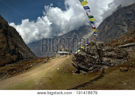 A tibetan house surrounded by the Langtang mountains.