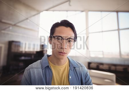 Portrait of confident businessman in brightly lit office