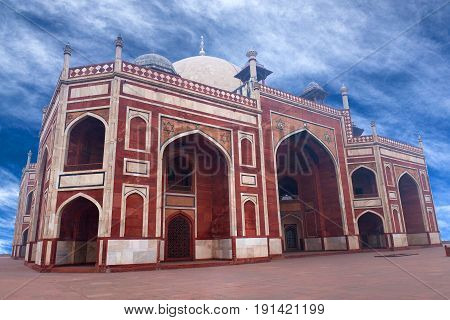 Humayun's Tomb in Delhi India. The tomb was commissioned by Humayun's son Akbar in 1569-70 and designed by Mirak Mirza Ghiyas a Persian architect chosen by Bega Begum.