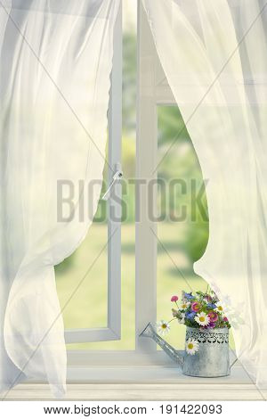 Watering can filled with flowers in open window with billowing curtains