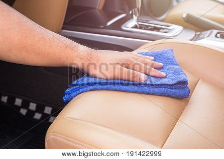 Hand Of People Holding Blue Microfiber Cloth And Cleaning Inside The Suv Car