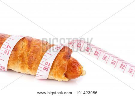 Sausage Bread And Measurement Tape. Studio Shot Isolated On White. Junk Food, Obesity Or Food Health