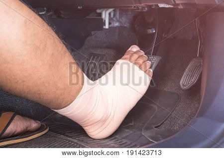 Right Foot With Bandage Cloth Step On The Brakes In The Modern Car. Injury And Driving Concept