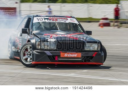 Lvov Ukraine - June 4 2016: Unknown rider on the car brand Mercedes-Benz overcomes the track in the championship of Ukraine drifting in Lvov Ukraine.