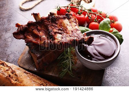 Spicy Hot Grilled Spare Ribs From A Summer Bbq Served With Fresh Tomatoes On An Old Vintage Wooden C
