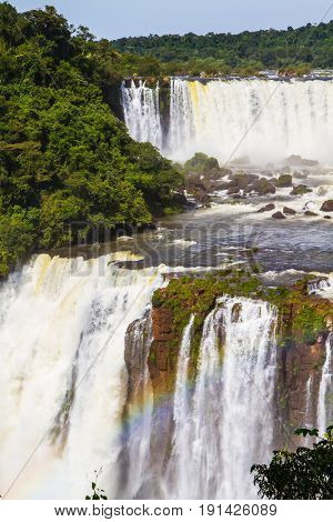 grandiose complex of waterfalls. The concept of extreme and exotic tourism. Multistage system of waterfalls creates rainbow