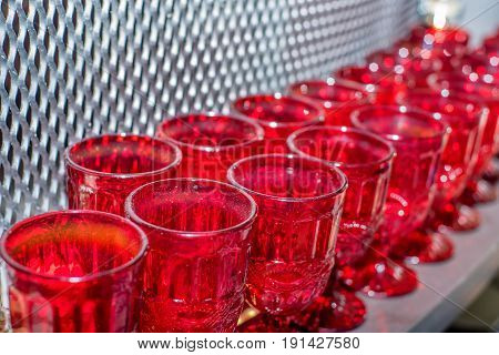 Closeup of emplty red wine glasses standing at dinner party or rout