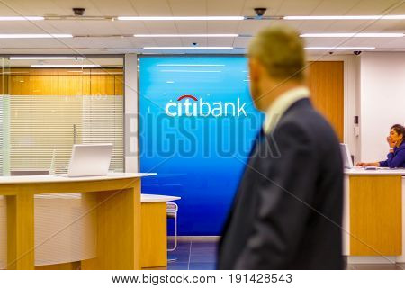 Citibank Sign Displayed At A Branch In Canary Wharf
