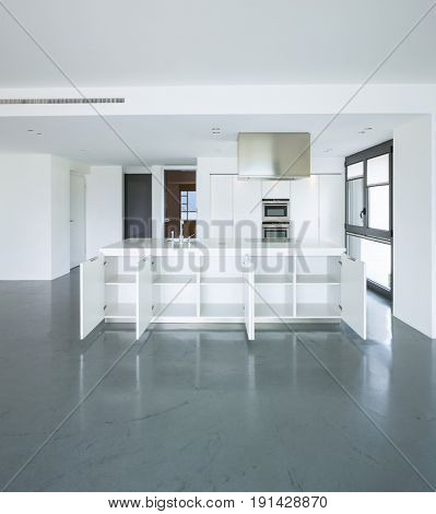 Frontal view of white kitchen in a modern apartment. Nobody inside