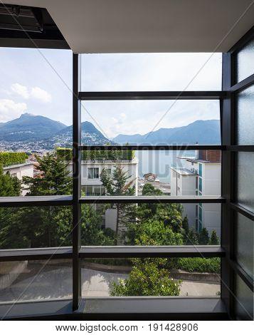 Detail of railing. Landscape of Lugano lake