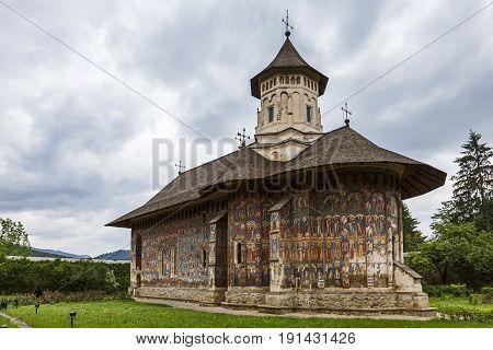 The orthodox monastery of Moldovita in summer , Bucovina, Romania.