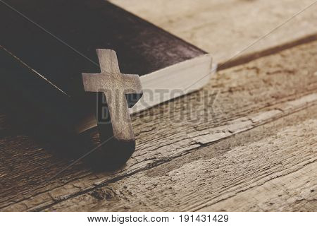 cross on the book on wooden  background
