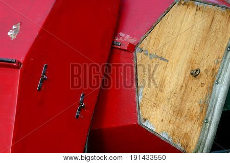 Colorful wooden boat being built outside for usage.