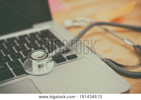 stethoscope and heart medical online concept, vintage tone