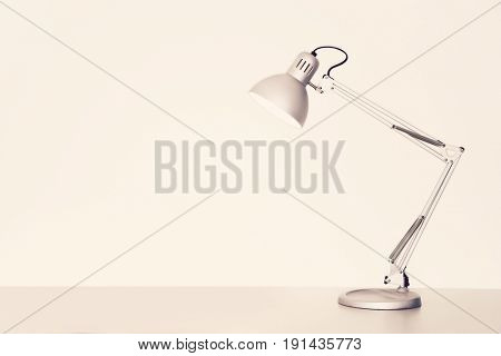 Desk lamp on table over white background