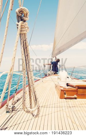 Man working on prow of yacht