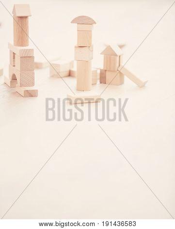 Wooden building blocks on hardwood floor
