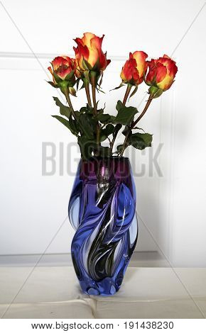 The bunch of red roses in glass vase