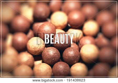 Beige cosmetics multicolor rouge balls background macro view
