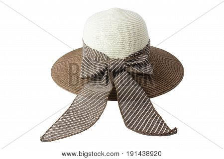 Woven hat with brown, beige, decorated with a pink bow tie, isolated on white background.