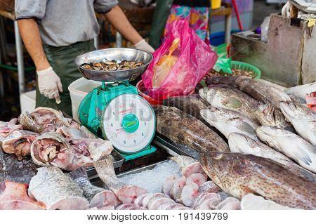 Man Sells Fresh Fish At The Wet Market