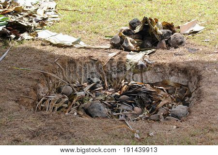 Traditional underground stove Traditional underground pit using heated stones and leaves and covered with earth to cook meat or root crops in the Pacific islands