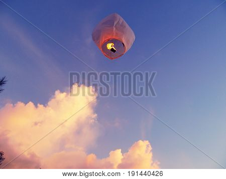 Sky lantern flying  A lighted paper lantern released into the air