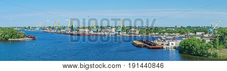 Panoramic view of the cargo river port in early morning at beginning of summer