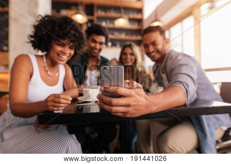 Group Of Friends Taking Selfie On Mobile Phone