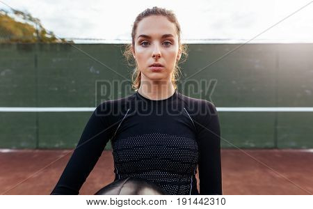 Portrait Of Young Sportswoman On Tennis Court