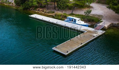 Nice Blue Boat on a Green Lake