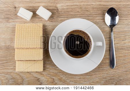 Coffee In Cup On Saucer, Spoon, Wafers And Lumpy Sugar