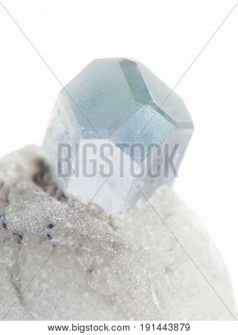Beautiful crystal of blue aquamarine gemstone in an albite matrix close-up isolated on a white background