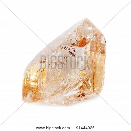 Natural crystal of clear precious wine topaz isolated on a white background