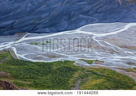 Aerial View Of Moraine Glacier River In South Iceland. Meandering River Net Between Bright Green For