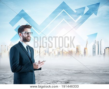 Side view of thoughtful young businessman using smartphone on city background with upward chart arrows. Finance concept