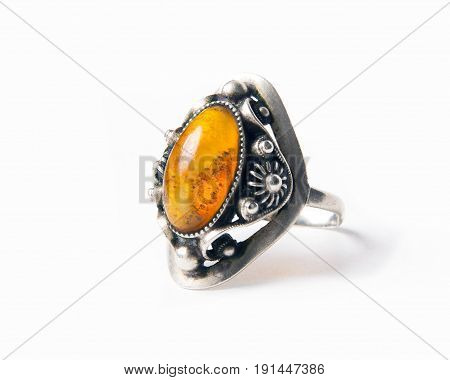 Vintage amber ring isolated on the white