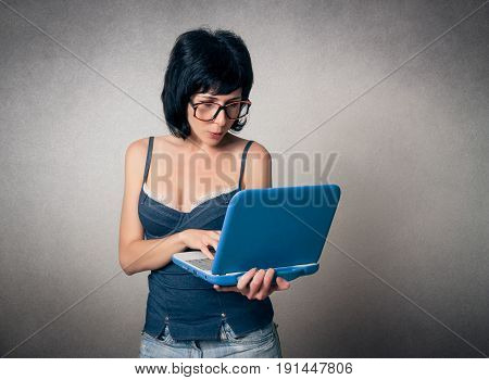 Funny woman close up using the laptop