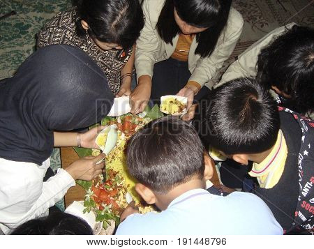 Nasi tumpeng is a yellow cone shaped rice form, people usualy round them to eat together after several rituals