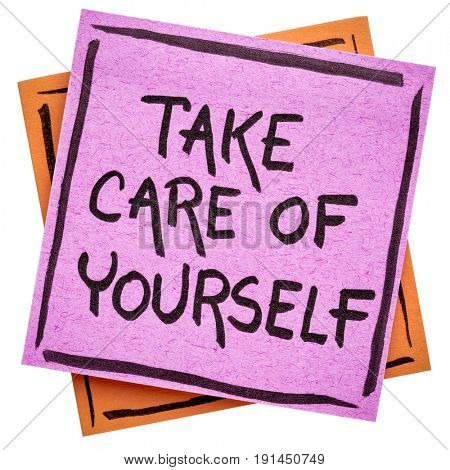 Take care of yourself reminder handwriting on an isolated sticky note