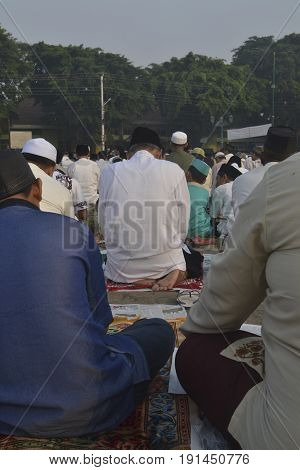 Muslem siiting in the field after shalat ied fitr