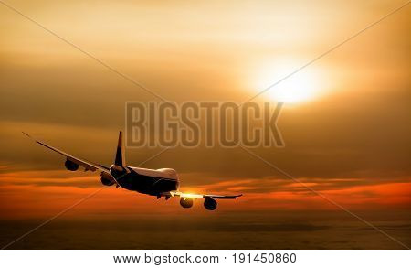 Airplane in the sky at sunset background