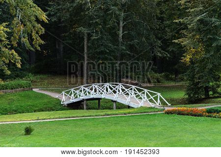 White wooden bridge in the old park in the village of Mikhailovskoye Pushkinsky Reserve Pskov region Russia