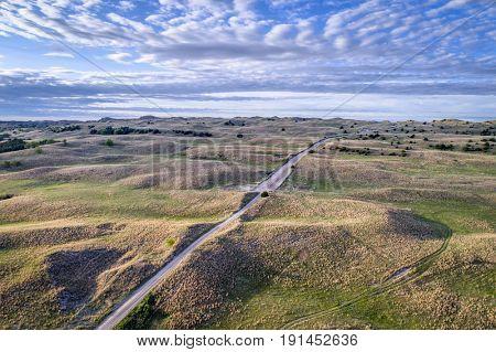 aerial view of sandy road in Nebraska Sandhills near Seneca, spring scenery with morning light