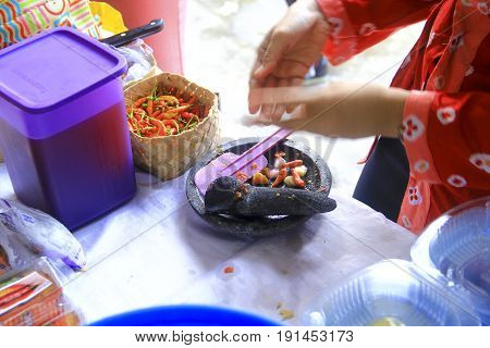 Sambal is a hot chili sauce with spices and another ingredient mix together with traditional stone grinder