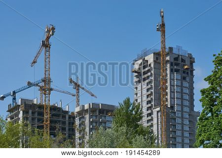 cityscape development of a new modern houses in urban city blue sky and trees around