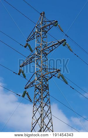 high voltage power line electricity pylon pole on blue sky