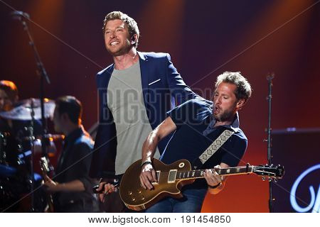 AUSTIN, TX - APRIL 30: Brett Eldredge (L) and Jesse Tucker perform during the 2016 iHeartCountry Festival at The Frank Erwin Center on April 30, 2016 in Austin, Texas.